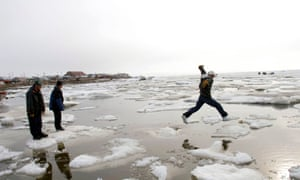 people jump over ice and water