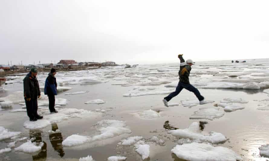 Teenagers go ice-hoping on the Chukchi Sea in Shishmaref, Alaska, US.
