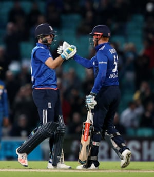 England's Johnny Bairstow, right, and Jos Buttler celebrate the win.