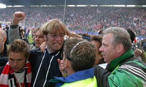 Jürgen Klopp is mobbed by Mainz fans after taking the club into the Bundesliga for the first time in 2004.