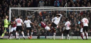 James Tomkins pulls a goal back for West Ham with a brave diving header.