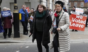Jess Phillips and Anna Soubry walk past Brexit campaigners