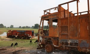 Burnt sand-carrying trucks lying by the ghat where sand mining took place near Jatpura village