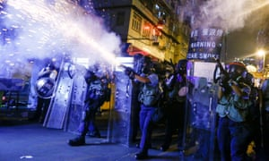Police fire tear gas at anti-extradition bill protesters during clashes in Sham Shui Po, Hong Kong, China