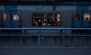 Commuters wearing masks ride a subway train amid the coronavirus disease pandemic in Seoul, South Korea 24 August 2020.