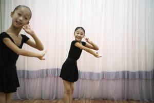 Young ballerinas practice during a class at Mansyongdae School Childrens' Palace.