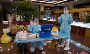 Medical staff wearing personal protection equipment prepare to test members of the foreign press invited to cover the opening of the Chinese People's Political And Consultative Conference early morning 21 May 2020 in Diaoyutai Hotel Beijing, China.