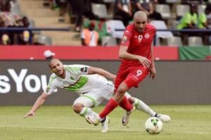 Tunisia's Ahmed Akaichi, right, gets the better of Algeria's Adlene Guedioura