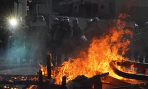 Police face a burning barricade during protests in Hong Kong.