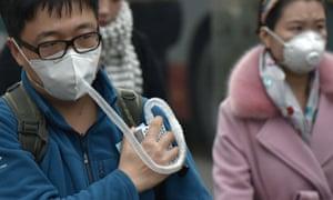 A man wears a respirator
