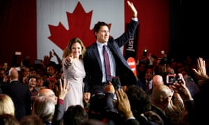 Liberal party leader Justin Trudeau and his wife Sophie Grégoire wave to supporters in Montreal after he won Canada's federal election