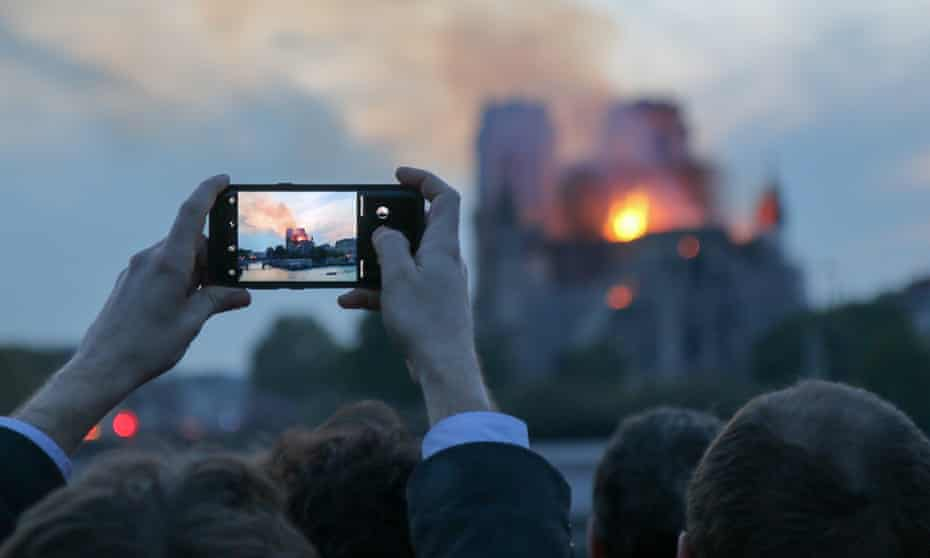 YouTube live stream video of the Notre Dame fire featured content of the September 11 attacks as related information.