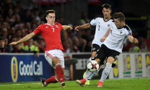 Wales' Tom Lawrence in action with Austria's Marcel Sabitzer and Stefan Lainer.