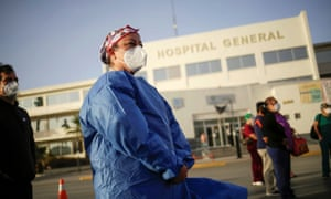 A health worker protests against a payment dispute and the lack of equipment to treat patients with the coronavirus in Ciudad Juarez, Mexico 9 November 2020.