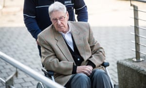 Former Auschwitz guard Reinhold Hanning arrives at court in Detmold, Germany.