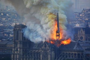 Smoke and flames rise during a fire at the landmark Notre-Dame Cathedral in central Paris