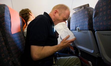 man vomiting on plane