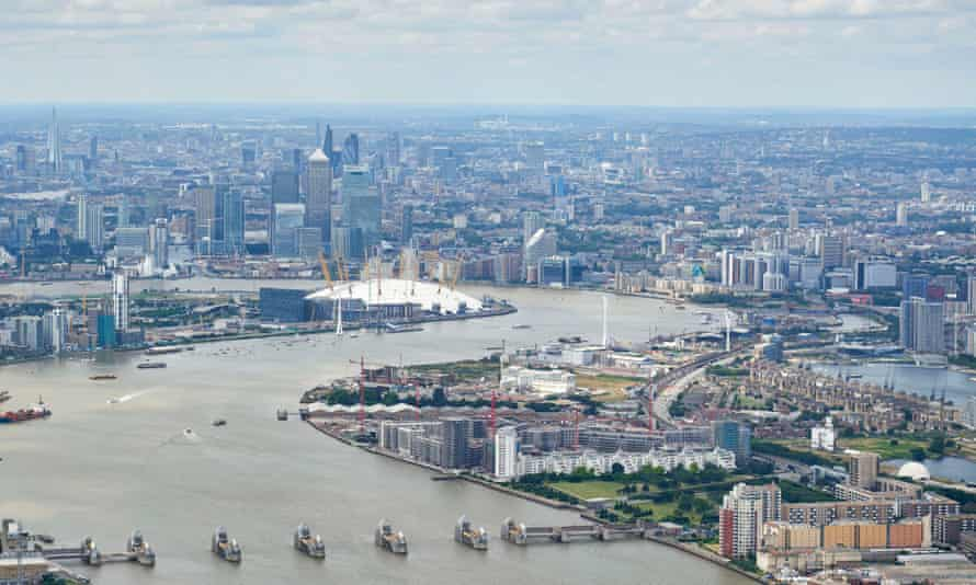 An aerial view looking up the river Thames over Greenwich Peninsula