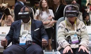2016 Consumer Electronics Show (CES) in Las Vegas<br>06 Jan 2016, Las Vegas, Nevada, USA --- Michon Ellis, left, and Dale Adamson use virtual reality goggles at the Kia booth at the 2016 International Consumer Electronics Show (CES) in Las Vegas, Nevada, USA, 06 January 2016. The goggles are set to simulate driving a Kia Soul. Photo: Jason Ogulnik/dpa --- Image by © Jason Ogulnik/dpa/Corbis