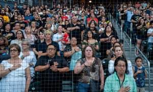 People attend a community memorial service at Southwest University Park in El Paso for the 22 victims of the recent mass shooting