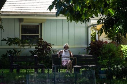 An older woman sits in the garden of John Knox Village, a retirement community in Pompano Beach, Florida.