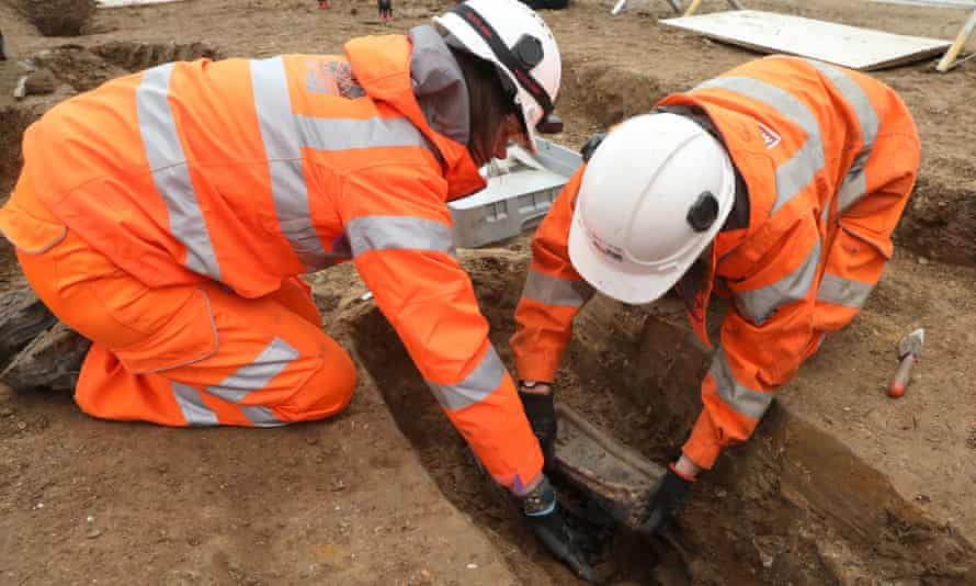 Archaeologists excavate a grave on the route of HS2 at a burial ground close to Euston station.