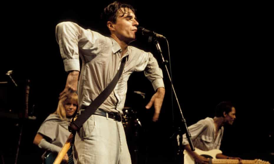 David Byrne in typical pose during Stop Making Sense.