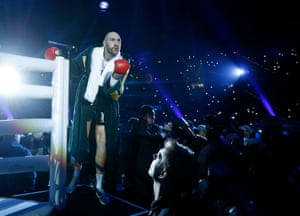 Fury gestures to fans as he enters the ring