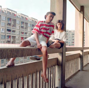 Daredevil sunbathers … Donna Hargreaves and Carmen Bello sit on an unguarded fourth storey concrete parapet, in a shot from Love Among the Ruins.