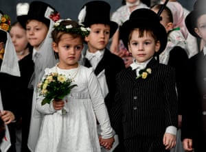 Children dressed as groom and bride during the Ptaci Kwas celebrations in Räckelwitz, near Bautzen, Germany