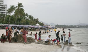 People gather on the beach on 24 May 2020 in Hua Hin, Thailand.