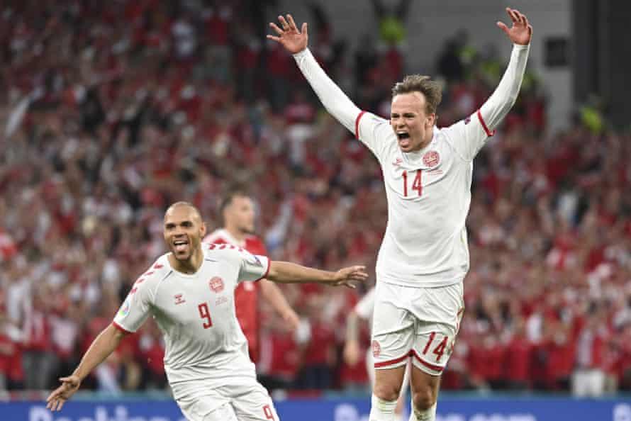 Mikkel Damsgaard scores Denmark's opener in the 4-1 victory over Russia.