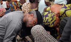 Nigerian vice-president Yemi Osinbajo welcomes some of the freed Chibok girls.