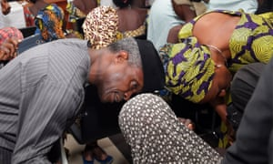 The vice-president, Yemi Osinbajo, speaks to one of the freed Chibok girls in Abuja last month.