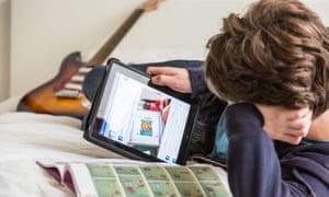Teenage boy looking at social media