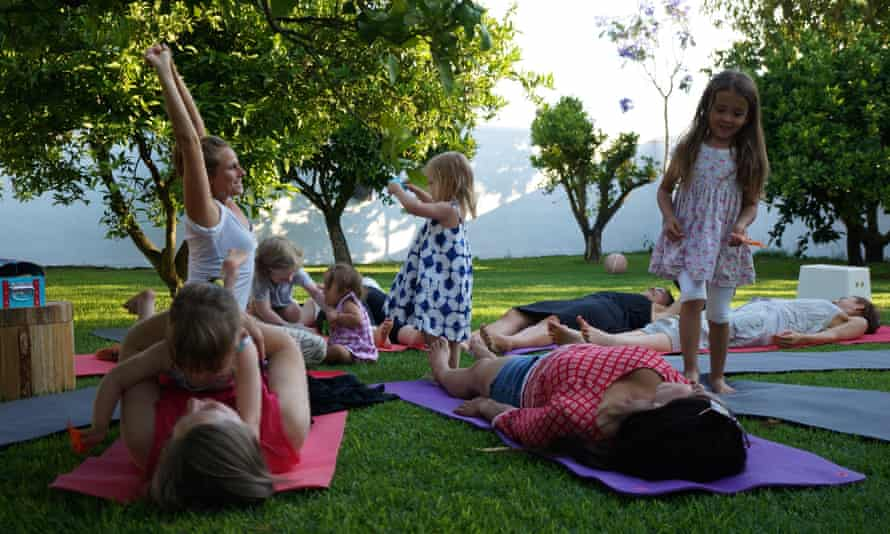 Fun with mum … the kids pile in at the end of a yoga session at HolyMama