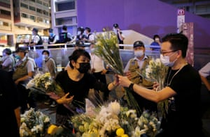 Protesters lay flowers near the Prince Edward MTR station, in Mongkok, where police clashed with protesters last year. Some believe demonstrators were killed in the station, an allegation authorities have denied.