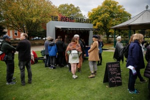 People queue for an instant poem about themselves at the Poetry Takeaway Van in Queens Gardens
