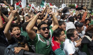 Fans watch the Mexico vs. Germany World Cup soccer match at an outdoor screen in Mexico City.