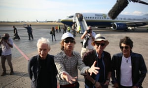 Charlie Watts, Mick Jagger, Keith Richards and Ronnie Wood talk to media on the runway