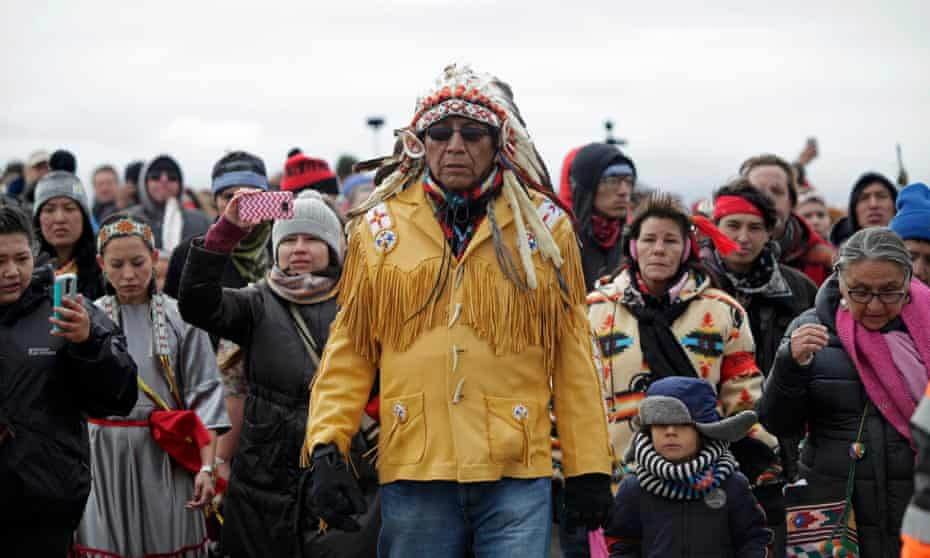 Chief Arvol Looking Horse, spiritual leader of the Sioux nation, leads his people to peacefully pray near a law enforcement barricade just outside of a Dakota Access pipeline construction site.