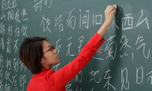 woman writing chinese characters on chalk