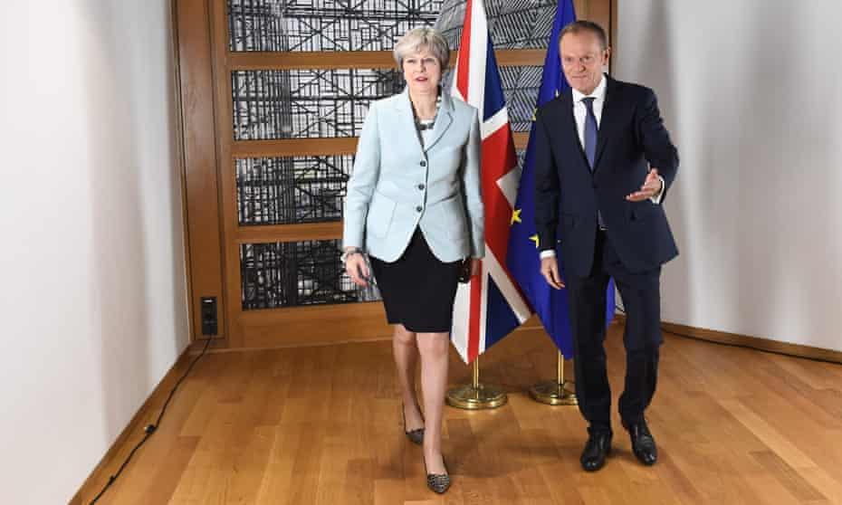 Theresa May and Donald Tusk leave after posing for photographers in Brussels after reaching a deal on 8 December 2017.