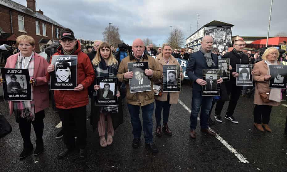 Family members of Bloody Sunday victims make their way to the Guildhall in Derry on 14 March.