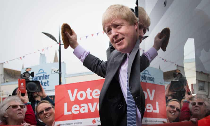 Boris Johnson holds aloft a Cornish pasty as he boards the Vote Leave campaign bus in Truro