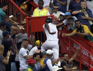 South Africa's bowler Kagiso Rabada, runs back to the players pavilion after taking seven wickets.