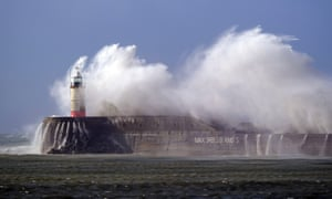 High winds and high seas batter the Newhaven lighthouse and harbour in East Sussex today