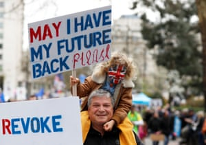 Child with sign: 'May I have my future back please?'