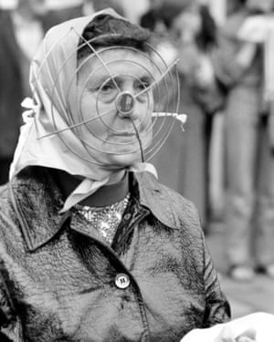 A local woman out shopping fashioned a makeshift mask to protect herself from flying bricks and bottles