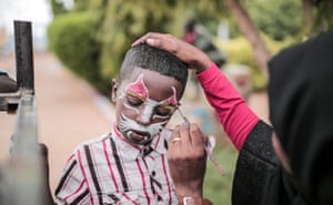 """Omdurman, Sudan A child has their face painted at an amusement park in Omdurman. Known as the """"big"""" festival, Eid Al-Adha is celebrated each year by Muslims sacrificing various animals according to religious traditions, including cows, camels, goats and sheep"""